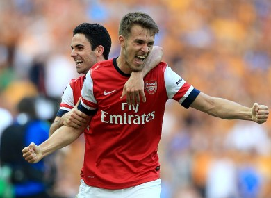 Arsenal's Aaron Ramsey (right) celebrates with team-mate Mikel Arteta after the game.