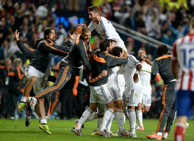 Real Madrid players celebrate an historic extra-time win.