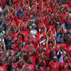Economic Freedom Fighters (EFF) supporters sing during their election rally at Lucas Moripe stadium in Atteridgeville, west of Pretoria, South Africa.<span class=