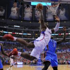 Los Angeles Clippers forward Glen Davis tries a circus shot.<span class=