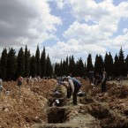 People prepare graves for the mine accident victims in Soma, Turkey. An explosion and fire at a coal mine in Soma, some 250 kilometres (155 miles) south of Istanbul, killed hundreds of workers, authorities said, in one of the worst mining disasters in Turkish history.<span class=