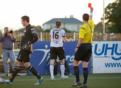 Dundalk's David McMillan is shown a red card.