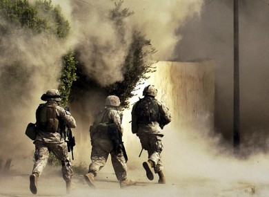 US Marines run to a building after detonating explosives. (File photo, 2004)