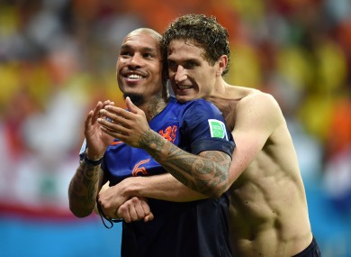 Netherlands' Nigel de Jong (left) and Daryl Janmaat celebrate after the game.