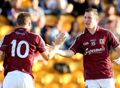 Galway's Danny Cummins celebrates scoring his side's third goal with Michael Lundy.