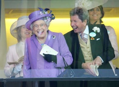 Queen Elizabeth II with her racing manager John Warren after her horse, Estimate, won the Gold Cup on day three of the Royal Ascot.