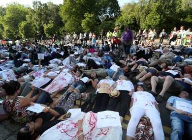 Hundreds of protesters lie down in front of the Department of Foreign Affairs in Dublin this evening.