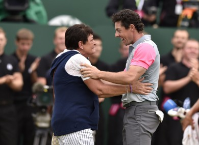 Rosie McIlroy celebrates with her son, Rory, after he won The Open.