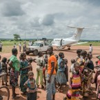 Displaced people at the airstrip in Carnot.<span class=