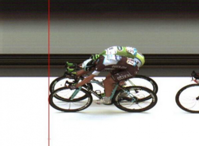 Matteo Trentin edges out Peter Sagan by the narrowest of margins.