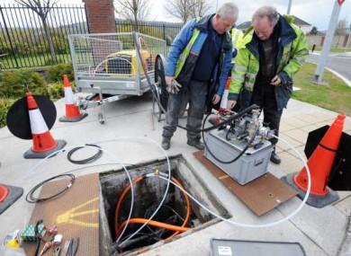 Eircom engineers installing broadband cable in Dublin.