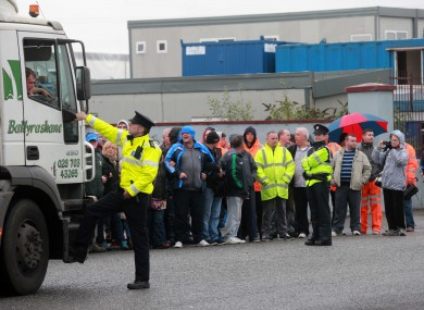 Gardai redirect trucks bound for Greyhound Recycling away from its entrance, which is blocked by supporters of the striking workers on Crag Avenue in Clondalkin this morning.