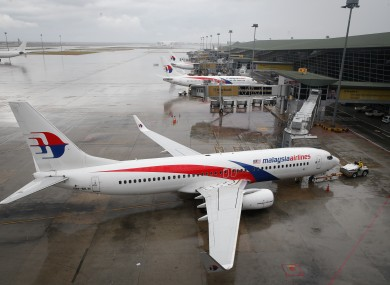 A Malaysia Airlines Boeing 737-800 plane sits on tarmac at Kuala Lumpur International Airport in Sepang, Malaysia