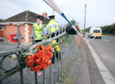 Flowers left at the scene in Charleville where the twins were found.