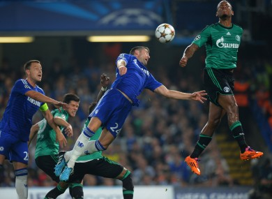 Gary Cahill of Chelsea dives for header during the UEFA Champions League, Group G match at Stamford Bridge.