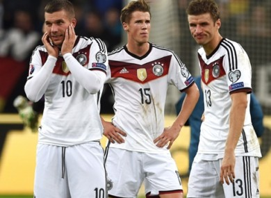 Podolski and his Germany teammates after the late Irish equaliser.