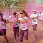 Competitors take part in the Dulux Color Run: runners are covered with coloured powder at each kilometre of the route, held at the Queen Elizabeth Olympic park, Stratford east London.