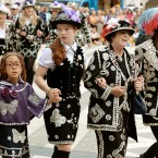 The Pearly Kings and Queens gather at the Guildhall Square as they parade to St Mary-le-Bow church to celebrate the harvest festival.