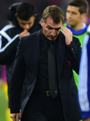Liverpool's Brendan Rogers walks off at the end of the Basel game.