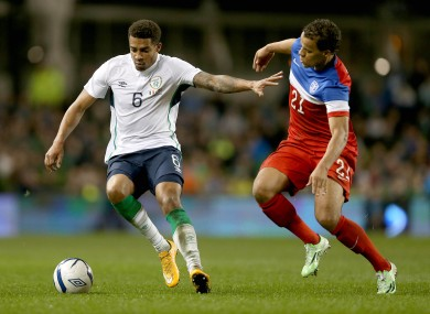 Cyrus Christie of Ireland with Timmy Chandler of USA.