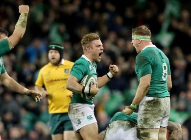 Peter O'Mahony, Ian Madigan and Jamie Heaslip celebrate Ireland's win this evening.