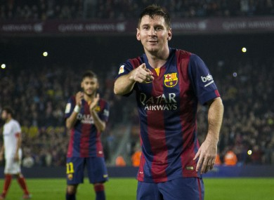 Lionel Messi celebrates his second goal against Sevilla surpassing Telmo Zarra's record of 251 goals in the Spanish league.