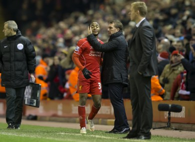 Liverpool's Raheem Sterling, centre left, is acknowleged by manager Brendan Rodgers after being substituted