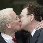 Michael Stark (left) and Michael Leshner kiss after their marriage in Toronto (2003, two years before same sex marriage became legal in all Canadian states).<span class=
