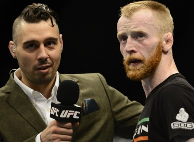 Holohan (right) speaking to Dan Hardy after his victorious UFC debut in Dublin last year.