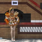 A dancer waits to perform in a pre-feast presentation in honor of Our Lady of Candelaria's upcoming feast day celebrations, at the Ministry of Culture in Lima, Peru, Thursday, Jan. 22, 2015. A 15-day festival takes place annually in the patron saint's honor in Puno, over 800 miles southeast of Lima. The cultural event, which begins Feb. 1, is recognized as one of the most popular and significant in South America.<span class=
