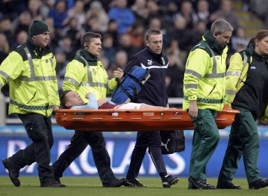 Burnley's Kevin Long is taken off injured during the Barclays Premier League match at St James' Park.