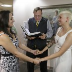 Yolanda Pascua (left) and Laekin Rogers getting married in Salt Lake City (2014).<span class=