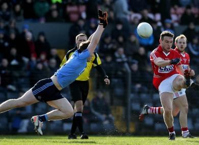 Dublin's John Small tries to block down Cork's John O'Rourke.
