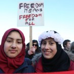 (LtoR) Abrar Mohamed and Lujain Bouh from Dublin protest as Anti Islam Ireland protesters protest across from The Islamic Cultural Centre of Ireland in Dublin this afternoon. <span class=