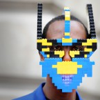 Paul 'bwoywonder' Allimadi wears a self-made LEGO mask at Somerset House, London as he attends a London Fashion Week event.<span class=