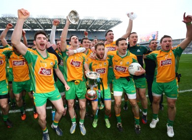 Corofin's players celebrate their victory today.