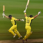 Australia's Shane Watson, right, and Steve Smith raise their bats and take the final run for their seven wicket win over New Zealand in the Cricket World Cup final in Melbourne, Australia. (AP Photo/Andy Brownbill)<span class=