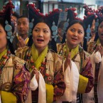 Tibetan artists in traditional costumes sing a welcome song for their spiritual leader the Dalai Lama on his arrival at the Tibetan Institute of Performing Arts in Dharmsala, India. The Dalai Lama watched the first day of the ten-day Shoton festival, or the yogurt festival, during which Tibetans eat yogurt and enjoy traditional opera performances. (AP Photo/Ashwini Bhatia)<span class=