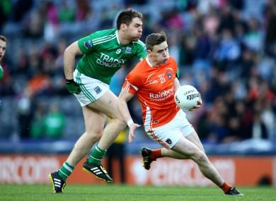 Armagh's Ciaran O'Hanlon is tackled by Richard O'Callaghan of Fermanagh.