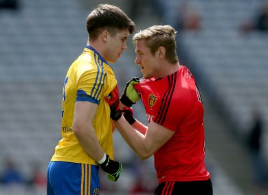 Roscommon's Conor Daly and Down's Caolan Mooney.