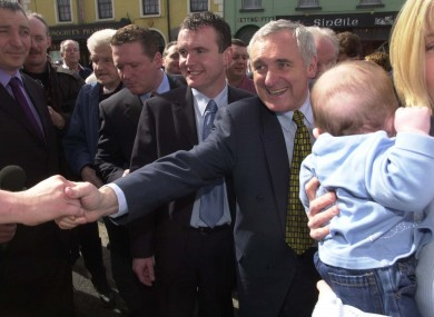 Handshakes and babies: Bertie Ahern out on a traditional street canvass in Virginia, Cavan ahead of the 2002 election.