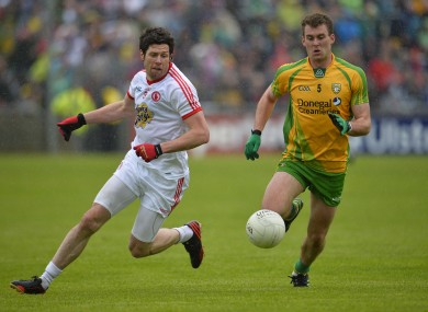 Tyrone's Sean Cavanagh (left) and Donegal's Eamonn McGee will renew acquaintances on Sunday