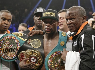 Floyd Mayweather Jr, left, poses with his champion's belt at the weekend.