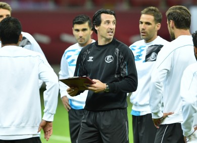 Sevilla's head coach Unai Emery instructs players during a training session last night.