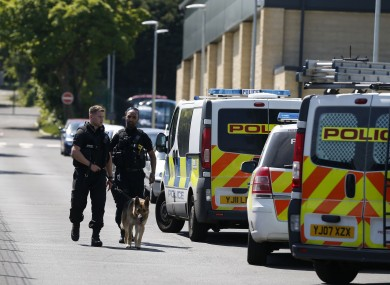 Police and a dog outside Dixons Kings Academy.