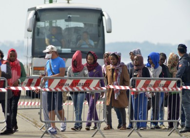Rescued migrants line up after disembarking from the Irish Navy ship LÉ Eithne in Taranto, Italy, earlier this month.