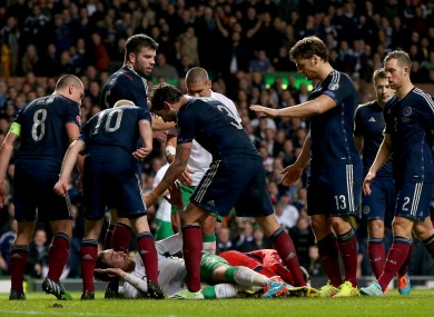Scotland's players surround Richard Keogh during Ireland's November defeat in Glasgow.