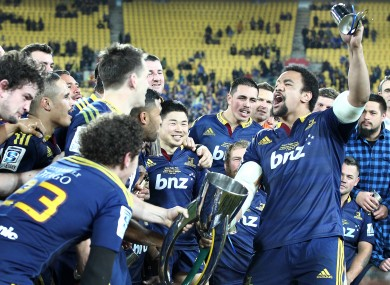 The Highlanders players celebrate with their team song at full-time.