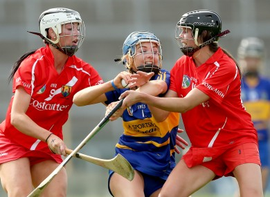 Cork's Ashling Thompson and Orla Cotter tackle Megan Ryan of Tipperary.