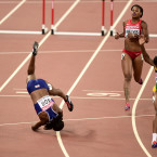 Team GB's Tiffany Porter has a brutal landing as she falls during the women's 100m hurdles in Beijing.